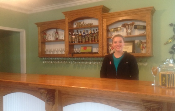 Brenna Staton, tasting room associate at Wildcat Creek Winery, often serves free wine to customers.